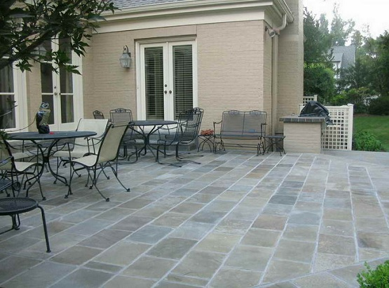 Outdoor tile for backyard patio with outdoor furniture
