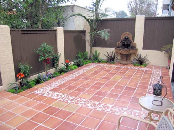 Outdoor tile for patio with brown wooden fence