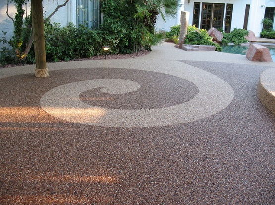 Pebble stone flooring in traditional patio