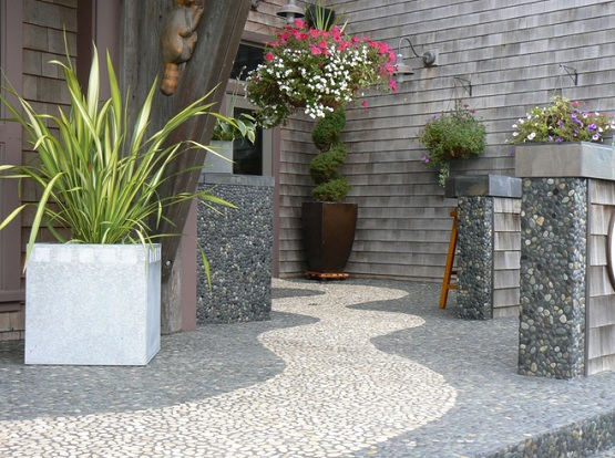 Pebble stone flooring installed at small terrace