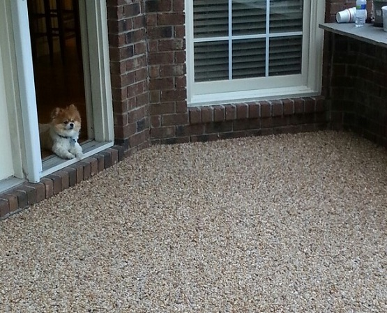 Pebble stone flooring installed in outdoor space