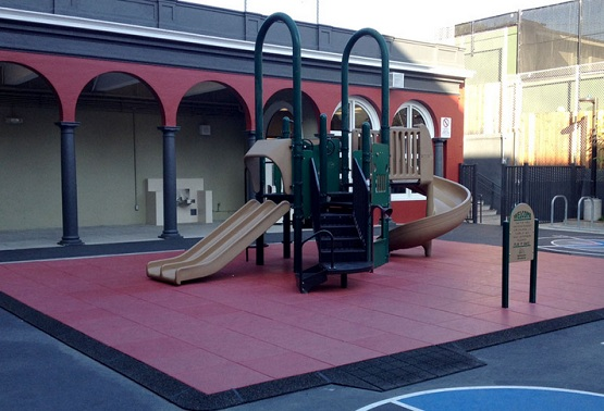 Red rubber playground mats in children's play areas