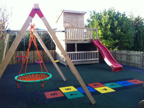 Rubber playground mats in a private garden
