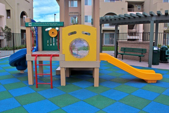 Rubber playground mats in small play areas