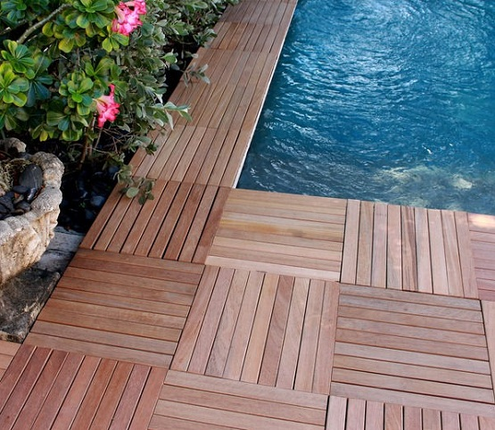Teak wood interlocking deck tiles installed around pool | Flooring ...