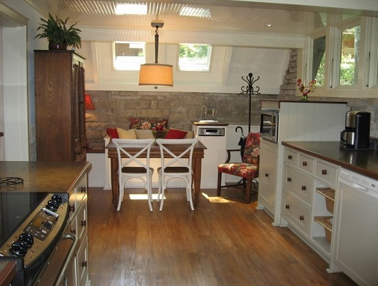 Waterproof wood flooring in kitchen with space saving dining sets furniture