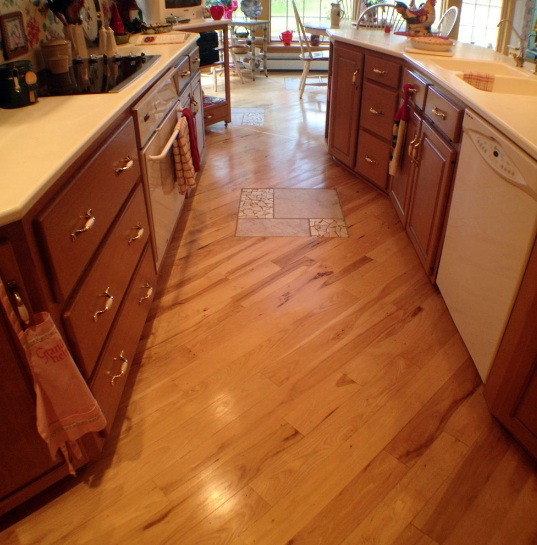 Wood flooring diagonal pattern installation in kitchen