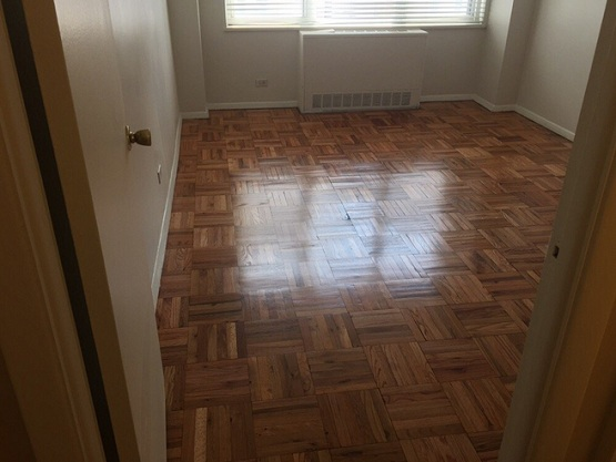 Wood flooring parquet pattern installation in bedroom