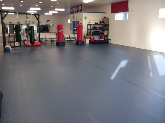 Black rubber flooring roll for basement exercise room