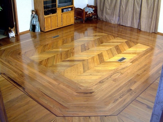 Different wood floors in house with traditional style installation