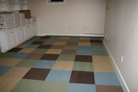 Interlocking rubber floor tiles for basement