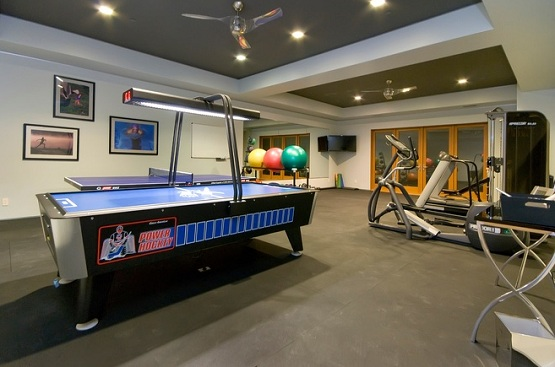 Large basement with rubber flooring rolls