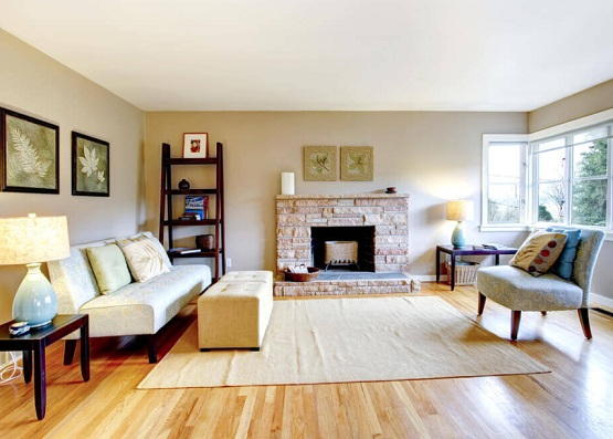 Light brown flooring options for living room with fireplace