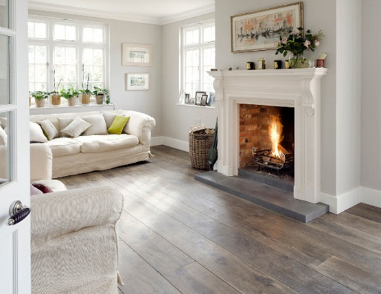 Natural grey wood floor stain in living room with fireplace