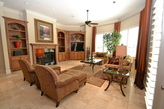 Travertine flooring options for living room with wooden furniture