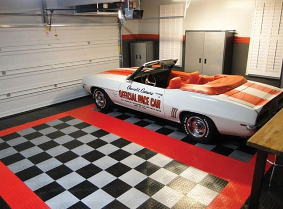 Black and white snap together garage flooring tiles with red border