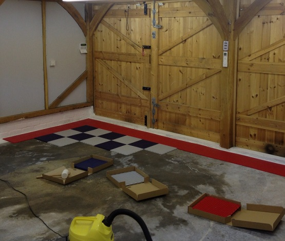 Snap together garage flooring tiles installation