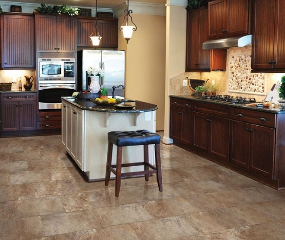 Vinyl flooring that looks like tile in kitchen with brown furniture