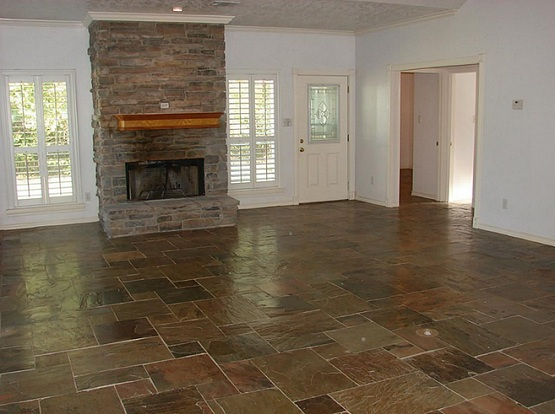 Natural slate flooring for living room with fireplace
