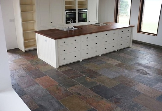 Natural slate flooring on small kitchen with wooden island ...