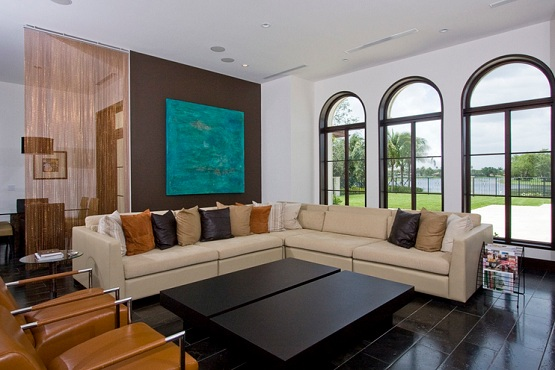 Simple black tiles design for living room with black wood table and brown sofa