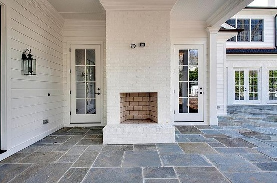 Slate patio tiles flooring on outdoor patio with fireplace ...