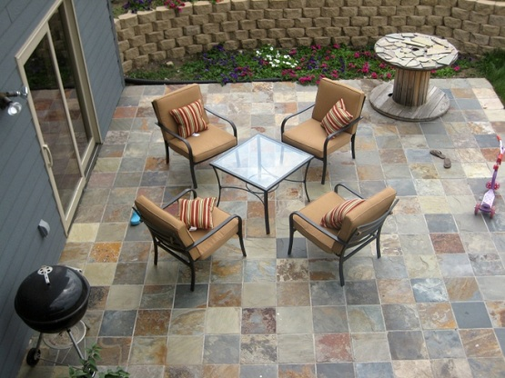 Slate patio tiles flooring with retro minimalist furniture