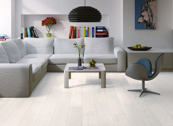 White oak laminate flooring for living room with gray sofa and hanging lamps