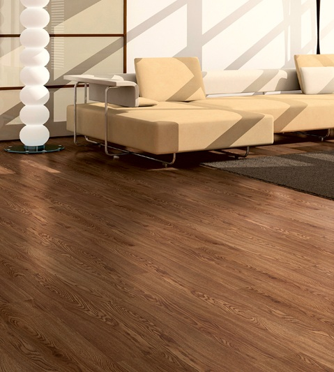 Antique oak laminate flooring in living room with contemporary furniture