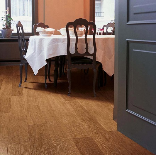 Antique oak laminate flooring with dark varnished