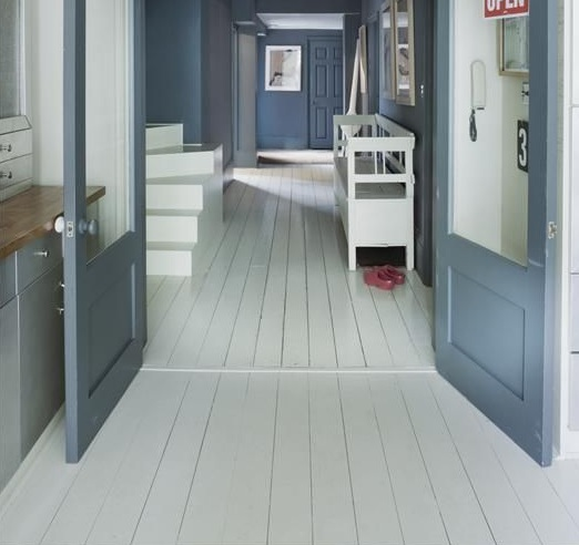 Modern hallway flooring ideas with white painted floorboard