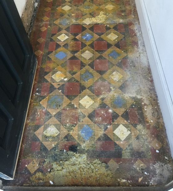 Victorian floor tiles look dull and dirty before cleaning