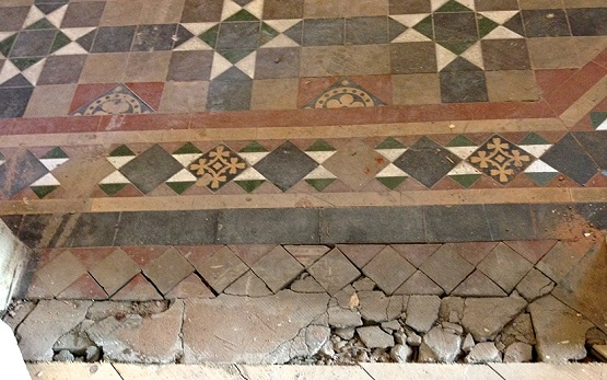 Victorian floor tiles missing and dirty cement grouting